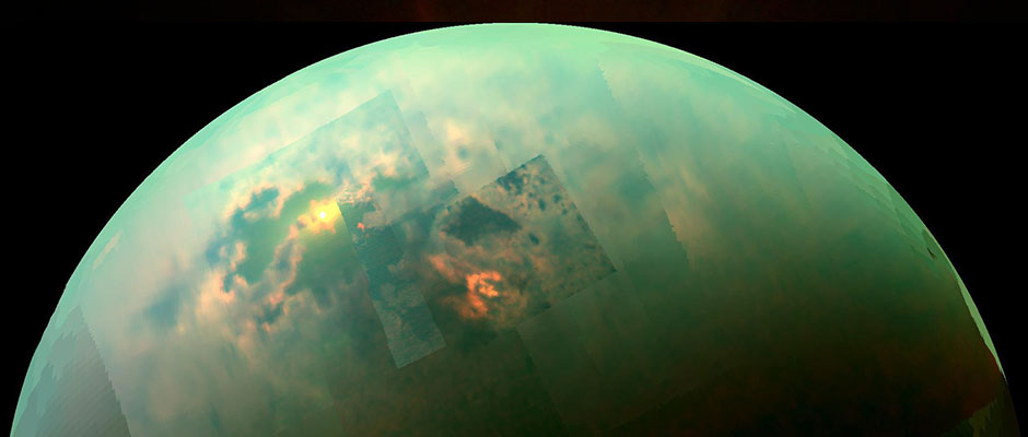 Image: NASA/JPL-Caltech/University of Arizona/University of Idaho.[/caption]  This near-infrared, colour mosaic from NASA's Cassini spacecraft shows the sun glinting off of Titan's north polar seas. While Cassini has captured, separately, views of the polar seas and the sun glinting off of them in the past, this is the first time both have been seen together in the same view.