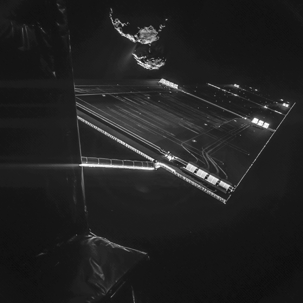 """The CIVA camera on the Philae lander snapped this """"selfie"""" while still attached to its mothership Oct. 7 showing one of Rosetta's two solar array wings and comet 67P/Churyumov-Gerasimenko. Image credit: ESA/Rosetta/Philae/CIVA"""