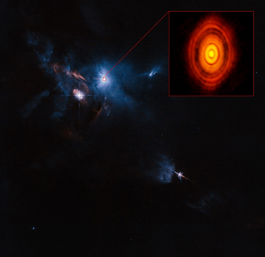 This is a composite image of the young star HL Tauri and its surroundings using data from ALMA (enlarged in box at upper right) and the NASA/ESA Hubble Space Telescope (rest of the picture). Image: ALMA (ESO/NAOJ/NRAO), ESA/Hubble and NASA.