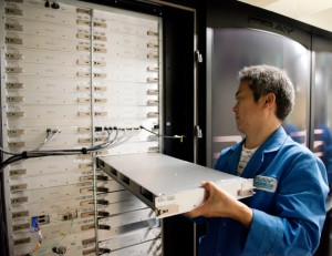 A Cray Japan Inc. engineer exchanging a blade in the ATERUI Cray XC30 supercomputer. In total, 266 blade units for calculations were replaced. Image credit: NAOJ