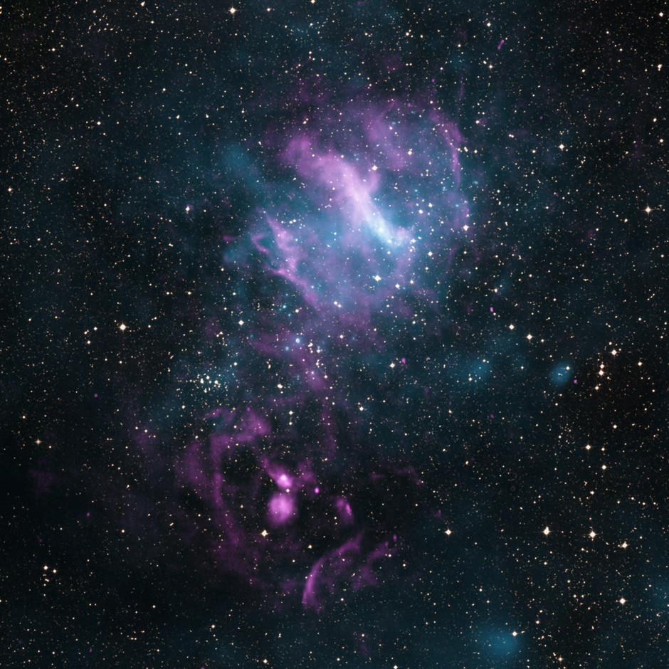 When X-rays, shown in blue, from Chandra and XMM-Newton are joined in this image with radio data from the Australia Telescope Compact Array (pink) and visible light data from the Digitized Sky Survey (DSS, yellow), a new view of the region emerges. This object, known as MSH 11-62, contains an inner nebula of charged particles that could be an outflow from the dense spinning core left behind when a massive star exploded. Image credit — X-ray: NASA/CXC/SAO/P.Slane et al; Optical: DSS; Radio: CSIRO/ATNF/ATCA