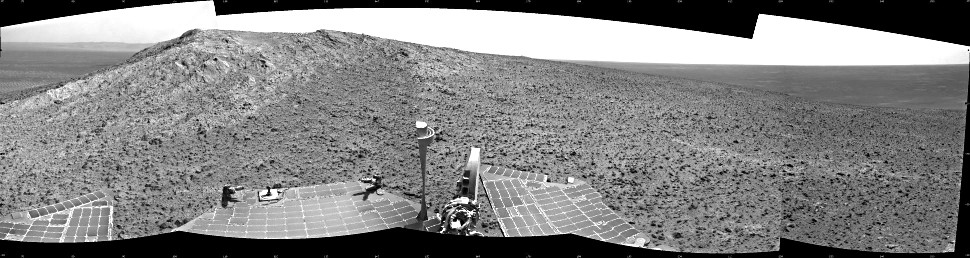 """NASA's Mars Exploration Rover Opportunity recorded this view of the summit of """"Cape Tribulation,"""" on the western rim of Endeavour Crater, on the day before the rover drove to the top. This view combines four images taken by Opportunity's navigation camera on 5th January 2015—the 3,893rd Martian day, or sol, of the rover's work on Mars. The summit is about 40 feet (about 12 meters) southwest of the location from which the images were taken.  Image credit: NASA/JPL-Caltech"""