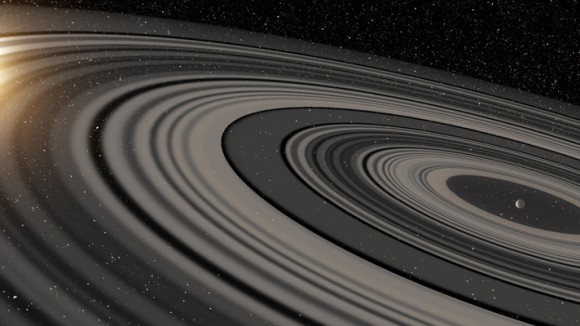 Artist's conception of the extrasolar ring system circling the young giant planet or brown dwarf J1407b. The rings are shown eclipsing the young sun-like star J1407, as they would have appeared in early 2007. Image credit: Ron Miller
