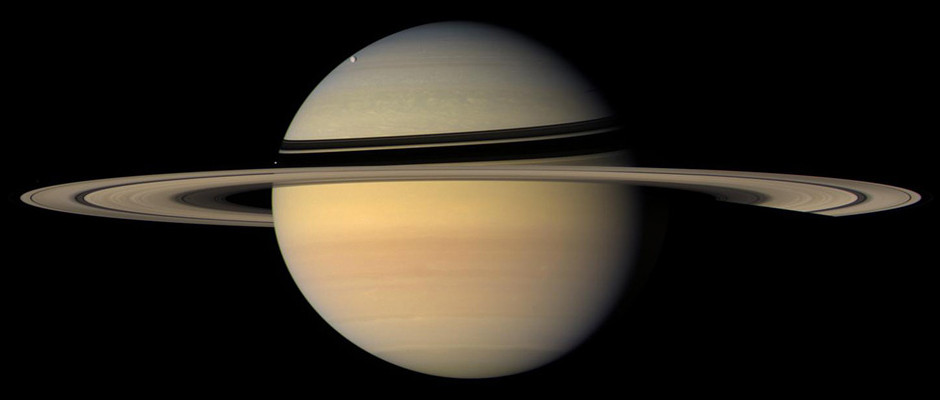 Researchers have determined the location of the Saturnian system's centre of mass to within just a couple of miles (or kilometres), a factor of 50 improvement over previous knowledge. Image credit: NASA/JPL/Space Science Institute