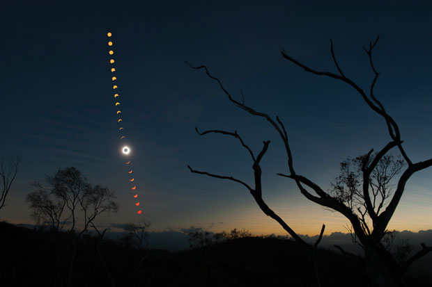 A digital multiple exposure of almost the entire solar eclipse seen from a hilltop about 20 miles west of the outback town of Mount Carbine, Queensland. Image: Ben Cooper/LaunchPhotography.com.