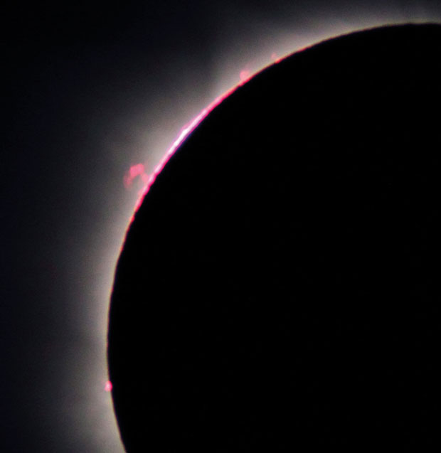 The chromosphere and prominences seen at third contact during the 2010 eclipse. Image: Nick James.