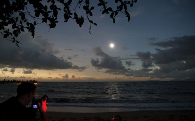 The clouds clear and the Sun is eclipsed at Palm Cove. Image: Steven Young.