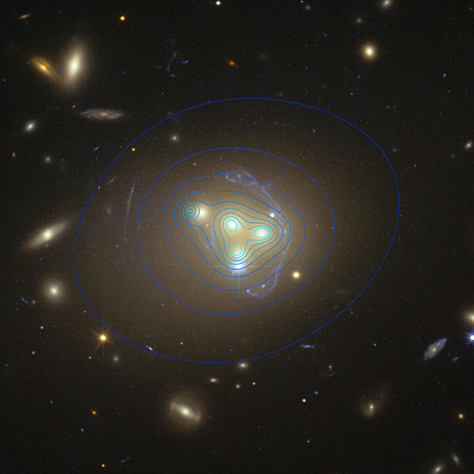 The distribution of dark matter in the rich galaxy cluster Abell 3827 is shown with blue contour lines. The dark matter clump for the galaxy at the left is significantly displaced from the position of the galaxy itself, possibly implying dark matter-dark matter interactions of an unknown nature are occurring. Image credit: ESO/R. Massey