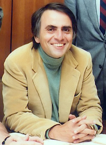 """Carl Sagan (1934-1996) pictured at the signing of the papers formally incorporating the The Planetary Society's organisation, circa 1970s. An American astronomer, cosmologist, astrophysicist, astrobiologist, author and science populariser, Sagan is best remembered for presenting and co-writing the award-winning 1980 television series """"Cosmos: A Personal Voyage."""" Image credit: NASA/JPL."""