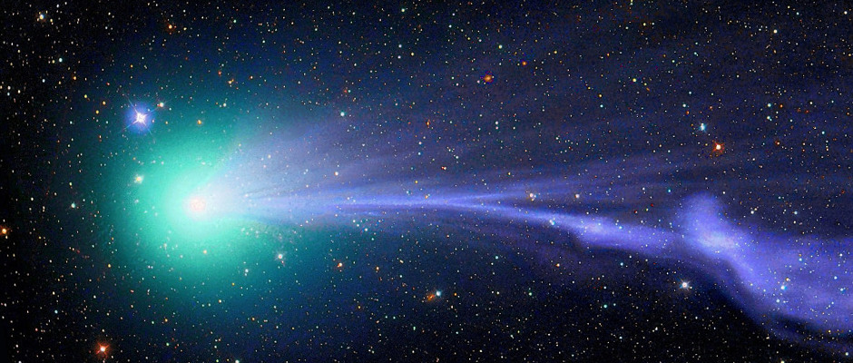 Comet Lovejoy sails through the solar system in a green haze leaving cometary dust in its wake. C/2014 Q2 is the fifth comet to have been discovered by Australian amateur astronomer and astrophotographer, Terry Lovejoy. Towards the end of 2014 and into the beginning of 2015 the comet could be seen through binoculars or in some special cases with the naked eye soaring through Earth's skies. The radiant blue-green contrasting against the backdrop of the night sky is due to the diatomic gas burning off it as it travels through space, and the disjointed tail illustrates the effects of a disturbance caused by solar winds. Image credit: © MichaelJaeger / RoyalMuseumsGreenwich.
