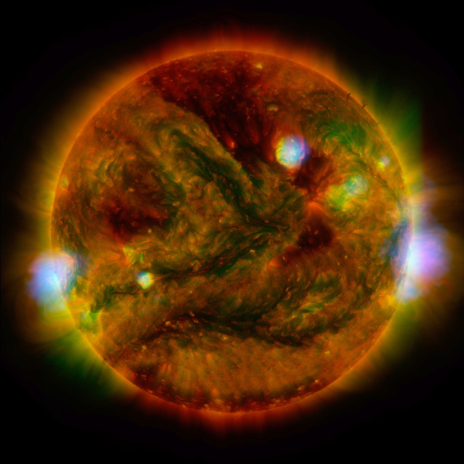 Flaring, active regions of our Sun are highlighted in this new image combining observations from several telescopes. High-energy X-rays from NASA's Nuclear Spectroscopic Telescope Array (NuSTAR) are shown in blue; low-energy X-rays from Japan's Hinode spacecraft are green; and extreme ultraviolet light from NASA's Solar Dynamics Observatory (SDO) are yellow and red. All three telescopes captured their solar images around the same time on 29 April 2015. The NuSTAR image is a mosaic made from combining smaller images. Image credit: NASA/JPL-Caltech/GSFC/JAXA.