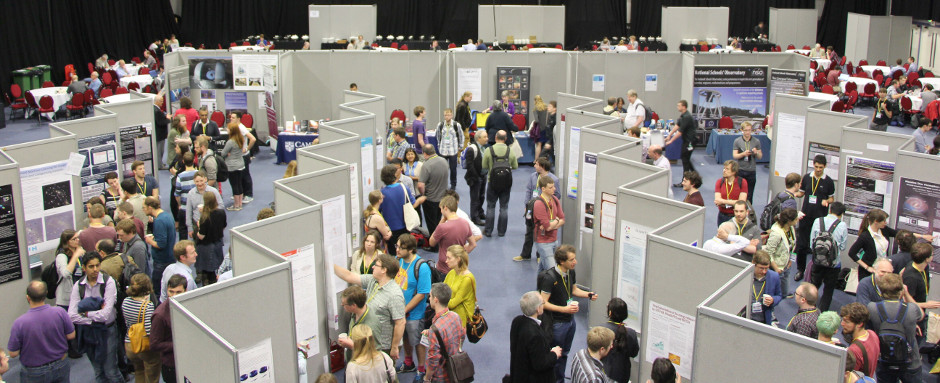 Attendees at the National Astronomy Meeting 2015 at Venue Cymru, Llandudno, looking at posters. Image credit: Sian Prosser, RAS.