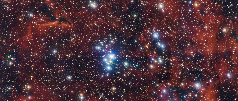 This rich view of an array of colourful stars and gas was captured by the Wide Field Imager (WFI) camera on the MPG/ESO 2.2-metre telescope at ESO's La Silla Observatory in Chile. It shows a young open cluster of stars known as NGC 2367, an infant stellar grouping that lies at the centre of an immense and ancient structure on the margins of the Milky Way. Image credit: ESO/G. Beccari.