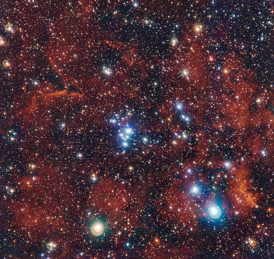 This rich view of an array of colourful stars and gas was captured by the Wide Field Imager (WFI) camera on the MPG/ESO 2.2-metre telescope at ESO's La Silla Observatory in Chile. It shows a young open cluster of stars known as NGC2367, an infant stellar grouping that lies at the centre of an immense and ancient structure on the margins of the Milky Way. Image credit: ESO/G. Beccari.