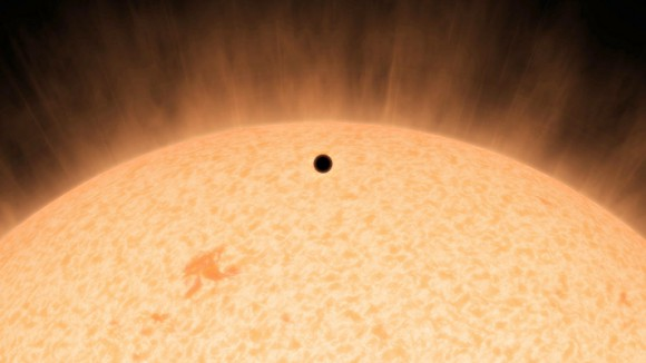 This artist's concept shows the silhouette of a rocky planet, dubbed HD219134b. At 21 light-years away, the planet is the closest outside of our solar system that can be seen crossing, or transiting, its star. Image credits: NASA/JPL-Caltech.