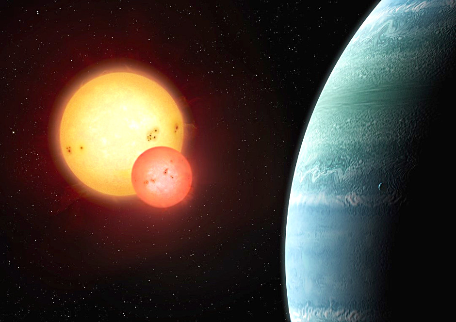 """An artist's impression of the newly discovered body known as Kepler-453b (right) that orbits a pair of suns, hence it is a """"circumbinary"""" planet, bringing the number of such known exoplanets into double digits. With a radius 6.2 times that of Earth, the new planet is a gas-giant that is unlikely to harbour life as we know it, but it does lie in the habitable zone of its host pair of stars. Kepler-453b takes 240 days to orbit its parent stars, while the stars orbit each other every 27 days. The system lies some 1,400 light-years away in the constellation Lyra. Illustration © Mark Garlick, markgarlick.com"""