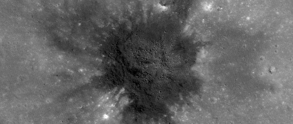 Some regions of the Moon exhibit dark mantling deposits that were formed by fire-fountain style eruptions, similar to Strombolian or some Hawaiian eruptions. This image is centered on a small impact crater (~170 metres in diameter) located within a larger regional pyroclastic deposit (5.470°N, 352.014°E) south of Sinus Aestuum. Since the crater has excavated fresh pyroclastic material from below, the freshly-exposed pyroclastics appear darker than the surrounding surface, possibly as a result of ejecta emplacement from impacts (both near and far afield) that deposited higher-reflectance material. Image credit: NASA/GSFC/Arizona State University.