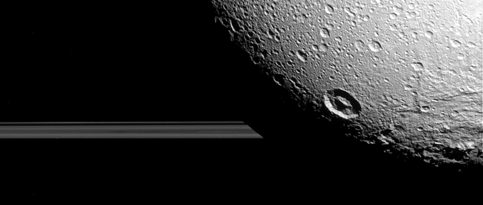 Saturn's moon Dione hangs in front of Saturn's rings in this view taken by NASA's Cassini spacecraft during the inbound leg of its last close flyby of the icy moon. North on Dione is up. The image was acquired in visible light with the Cassini spacecraft narrow-angle camera on 17 August 2015. The view was acquired at a distance of approximately 98,000 miles (158,000 kilometres) from Dione and at a sun-Dione-spacecraft, or phase, angle of 35 degrees. Image scale is 3,100 feet (950 metres) per pixel. Image credit: NASA/JPL-Caltech/Space Science Institute.
