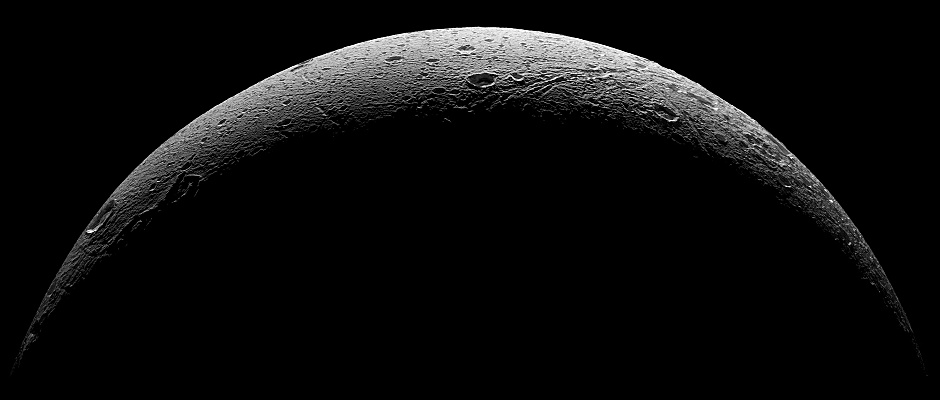 Five visible light (clear spectral filter), narrow-angle camera images from NASA's Cassini spacecraft were combined to create this mosaic of Dione's parting view. The scene is an orthographic projection centred on terrain at 0.4 degrees north latitude, 30.6 degrees west longitude on Dione. The view was acquired at distances ranging from approximately 37,000 miles (59,000 kilometres) to 47,000 miles (75,000 kilometres) from Dione and at a phase angle of 145 degrees. Image scale is about 1,300 feet (400 metres) per pixel. North on Dione is up and rotated 34 degrees to the right. Image credit: NASA/JPL-Caltech/Space Science Institute.