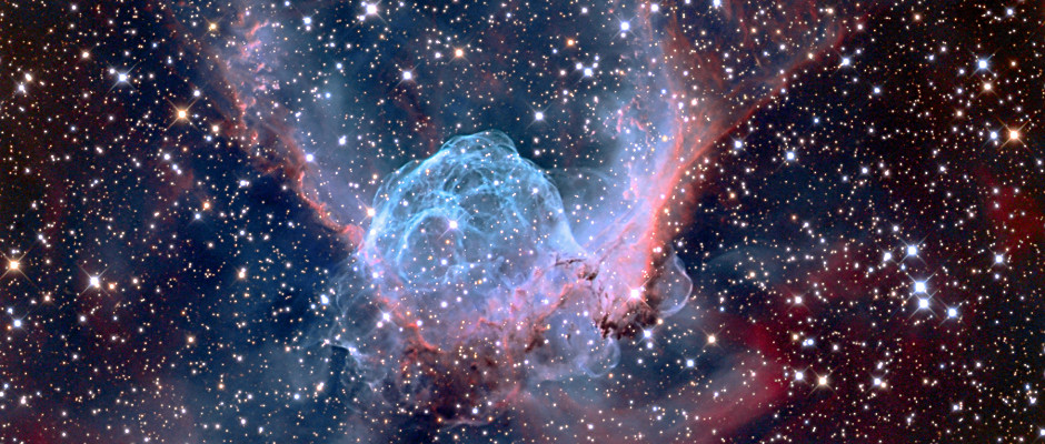 The distinctive shape of the nebula NGC2359 has led to it also being known as Thor's Helmet, resembling the headgear of the Norse God (and Marvel superhero). Around 11 thousand light-years away, the overall bubble shape is mainly due to interstellar material swept up by the winds of the nebula's central Wolf-Rayet star, an extremely hot giant thought to be in a pre-supernova stage. Image credit: © AdamBlock / RoyalMuseumsGreenwich.