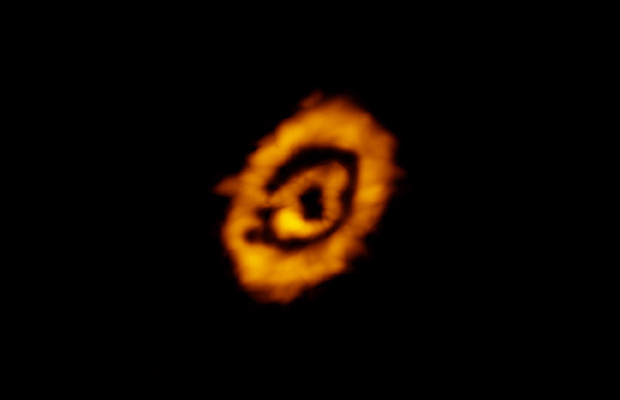 Atacama Large Millimeter/submillimetre Array (ALMA) image of dual rings of DCO+ encircling the star IMLup. The rings reveal details about the conditions of this young protoplanetary disc. The existence of the outer ring was surprising, providing new insights into the formation of heavy molecules — those based on deuterium — in this and other similar systems. Image credit: K. Oberg, CfA, et al.; ALMA (NRAO/ESO/NAOJ); B. Saxton (NRAO/AUI/NSF).