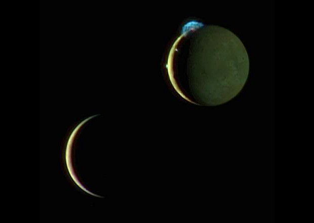 This is a composite image of Io and Europa taken 2 March 2007 with the New Horizons spacecraft. Here Io is at the top with three volcanic plumes visible. The 300-kilometre (190-mile) high plume from the Tvashtar volcano is at the 11 o'clock position on Io's disc, with a smaller plume from the volcano Prometheus at the 9 o'clock position on the edge of Io's disc, and the volcano Amirani between them along the line dividing day and night. Image credits: NASA/JHU Applied Physics Laboratory/Southwest Research Institute.