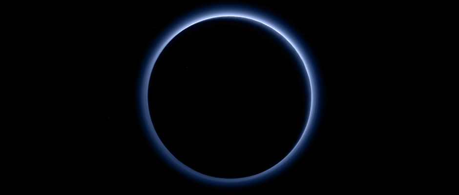 Pluto's haze layer shows its blue colour in this picture taken by the New Horizons Ralph/Multispectral Visible Imaging Camera (MVIC). The high-altitude haze is thought to be similar in nature to that seen at Saturn's moon Titan. The source of both hazes likely involves sunlight-initiated chemical reactions of nitrogen and methane, leading to relatively small, soot-like particles (called tholins) that grow as they settle toward the surface. This image was generated by software that combines information from blue, red and near-infrared images to replicate the colour a human eye would perceive as closely as possible. Image credits: NASA/JHUAPL/SwRI.