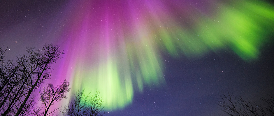 This image of a colourful aurora was taken in Delta Junction, Alaska, on 10April 2015. All aurorae are created by energetic electrons, which rain down from Earth's magnetic bubble and interact with particles in the upper atmosphere to create glowing lights that stretch across the sky. Image courtesy of Sebastian Saarloos.