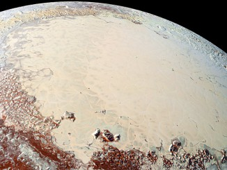 "This high-resolution image captured by NASA's New Horizons spacecraft combines blue, red and infrared images taken by the Ralph/Multispectral Visual Imaging Camera (MVIC). Pluto's surface shows a remarkable range of subtle colours, digitally enhanced in this view to a rainbow of pale blues, yellows, oranges, and deep reds. The bright expanse is the western lobe of the ""heart,"" informally known as Tombaugh Regio. The lobe, informally called Sputnik Planum, has been found to be rich in nitrogen, carbon monoxide, and methane ices. Pluto's diameter is 1,473 miles (2,372 kilometres). Image credit: NASA/Johns Hopkins University Applied Physics Laboratory/Southwest Research Institute."