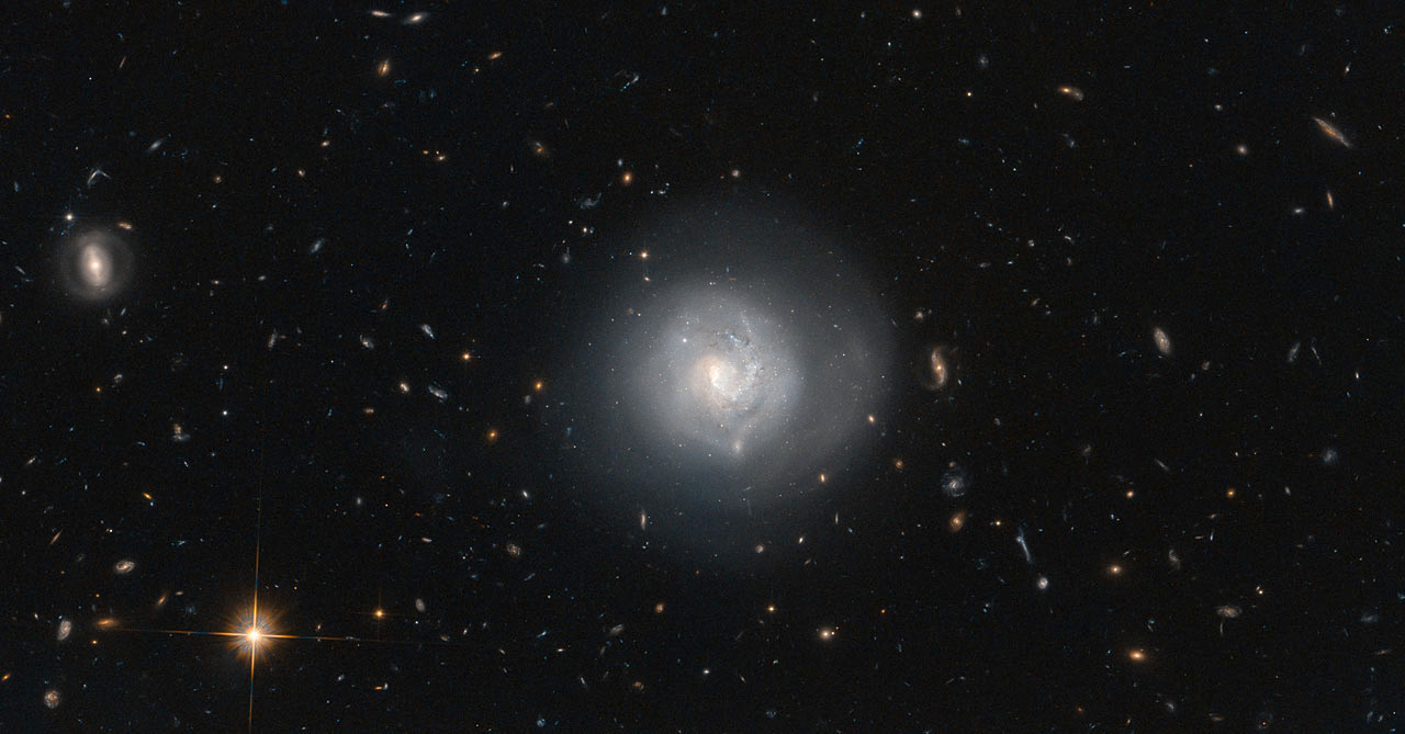 This Hubble image shows the lenticular galaxy Markarian 820, also known as Mrk 820. It lies in the constellation Bootes, about 300million light-years from Earth. Image credit: ESA/Hubble & NASA and N. Grogin (STScI), Acknowledgement: Judy Schmidt.
