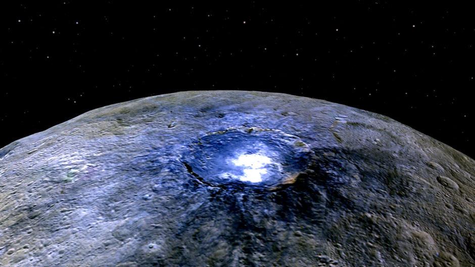 This representation of Ceres' 60-mile-wide Occator Crater in false colours shows differences in the surface composition. Image credits: NASA/JPL-Caltech/UCLA/MPS/DLR/IDA.
