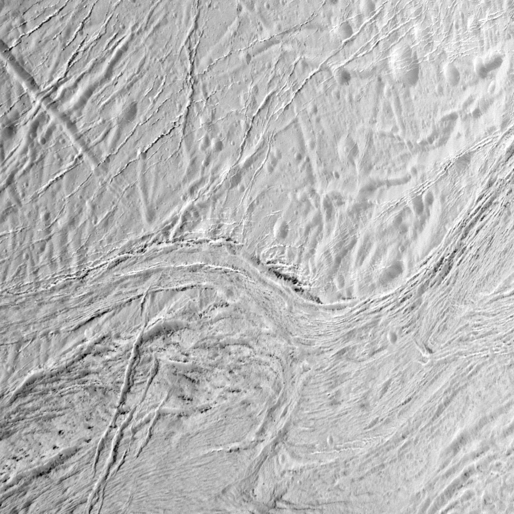 During its final close flyby of Saturn's moon Enceladus, NASA's Cassini spacecraft captured this view featuring the nearly parallel furrows and ridges of the feature named Samarkand Sulci. This view is centered on terrain at 13 degrees north latitude, 336 degrees west longitude. The image was taken with the Cassini spacecraft narrow-angle camera on 19 December 2015, using a spectral filter, which preferentially admits wavelengths of near-ultraviolet light. The view was acquired at a distance of approximately 8,000 miles (12,000 kilometres) from Enceladus. Image scale is 243 feet (74 metres) per pixel. Image credit: NASA/JPL-Caltech/Space Science Institute.