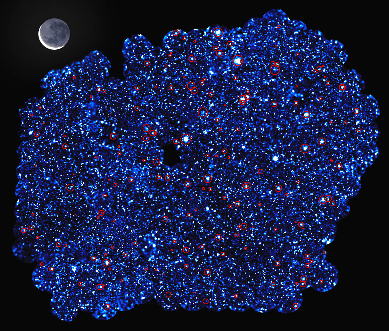 This image shows XXL-South Field (or XXL-S), one of the two fields observed by the XXL survey, with the size of the Moon for scale.  XXL is one of the largest quests for galaxy clusters ever undertaken and provides by far the best view of the deep X-ray sky yet obtained. The survey was carried out with ESA's XMM-Newton X-ray observatory. Additional vital observations to measure the distances to the galaxy clusters were made with ESO facilities. The red circles in this image show the clusters of galaxies detected in the survey. Along with the other field — XXL-North Field (or XXL-N) — around 450 of these clusters were uncovered in the survey, which mapped them back to a time when the universe was just half of its present age. The image also reveals some of the 12,000 galaxies that had very bright cores containing supermassive black holes that were detected in the field. Image credit: ESA/XMM-Newton/XXL survey consortium/(S. Snowden, L. Faccioli, F. Pacaud).