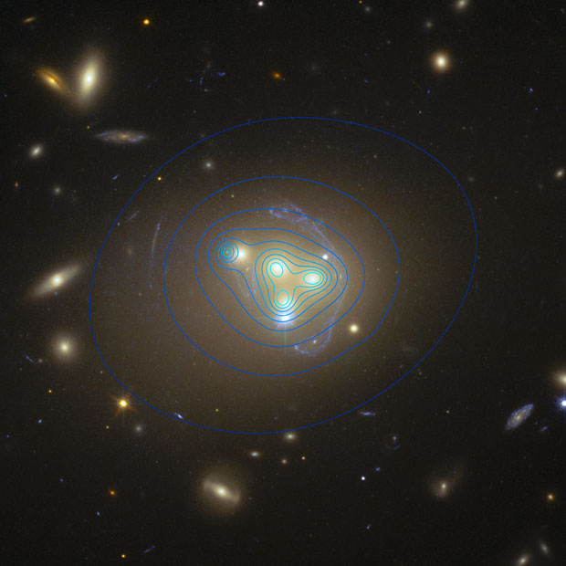 The merger of four galaxies in the Abell 3827 cluster. The blue contour lines indicate the density of the dark matter clumps around them, and the clump for the galaxy on the left is lagging behind it. Image: ESO/R Massey.