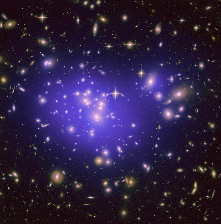 This image from NASA/ESA's Hubble Space Telescope shows the inner region of Abell1689, an immense cluster of galaxies. Scientists say the galaxy clusters we see today have resulted from fluctuations in the density of matter in the early universe. Image credit: NASA/ESA/JPL-Caltech/Yale/CNRS.