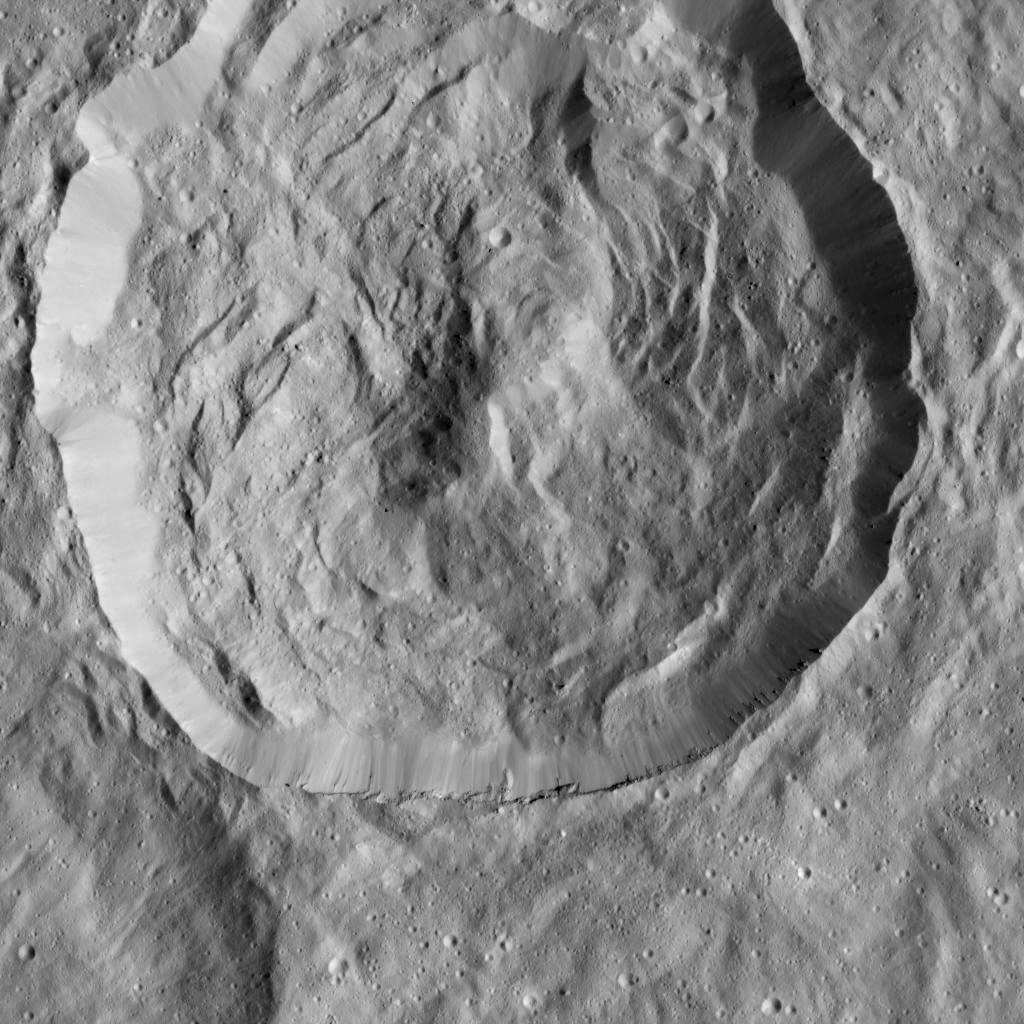 NASA's Dawn spacecraft viewed this Cerean crater, which is covered in ridges and steep slopes, called scarps on 23December 2015. These features likely resulted when the crater partly collapsed during its formation. The curvilinear nature of the scarps resembles those on the floor of Rheasilvia, the giant impact crater on Vesta, which Dawn orbited from 2011 to 2012. The 20-mile-wide (32-kilometre-wide) crater is located just west of the larger, named crater Dantu, at northern mid-latitudes on Ceres. Both of these impact features were captured during Dawn's Survey orbit. Image credit: NASA/JPL-Caltech/UCLA/MPS/DLR/IDA.