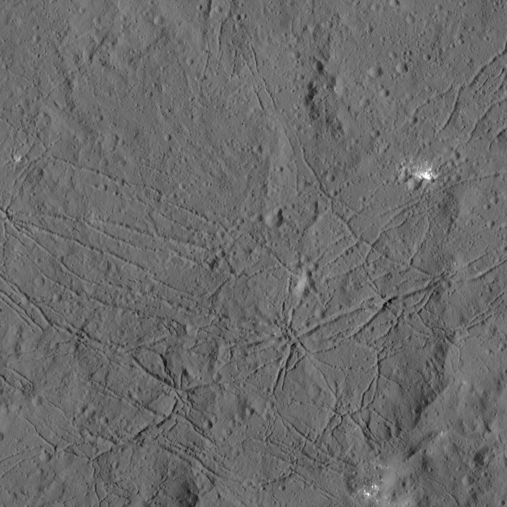 The fractured floor of Dantu Crater on Ceres is seen in this image from NASA's Dawn spacecraft. Similar fractures are seen in Tycho, one of the youngest large craters on Earth's Moon. This cracking may have resulted from the cooling of impact melt, or when the crater floor was uplifted after the crater formed. Image credit: NASA/JPL-Caltech/UCLA/MPS/DLR/IDA.