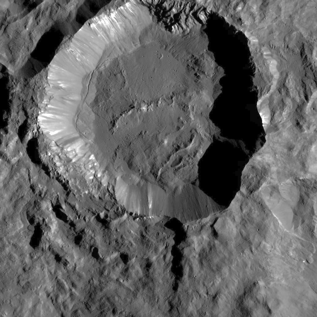 This image from NASA's Dawn spacecraft shows Kupalo Crater, one of the youngest craters on Ceres. The crater has bright material exposed on its rim and walls, which could be salts. Its flat floor likely formed from impact melt and debris. Kupalo, which measures 16 miles (26 kilometres) across and is located at southern mid-latitudes, is named for the Slavic god of vegetation and harvest. Image credit: NASA/JPL-Caltech/UCLA/MPS/DLR/IDA.
