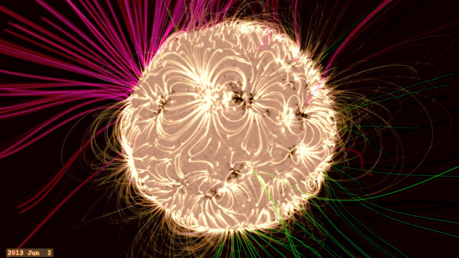 A frame from movie (see below) where NASA Goddard solar scientist Holly Gilbert explains a computer model of the Sun's magnetic field. Grasping what drives that magnetic system is crucial for understanding the nature of space throughout the solar system. The Sun's invisible magnetic field is responsible for everything from the solar explosions that cause space weather on Earth — such as aurorae — to the interplanetary magnetic field and radiation through which our spacecraft journeying around the solar system must travel. Image credit: NASA's Goddard Space Flight Center/Duberstein.