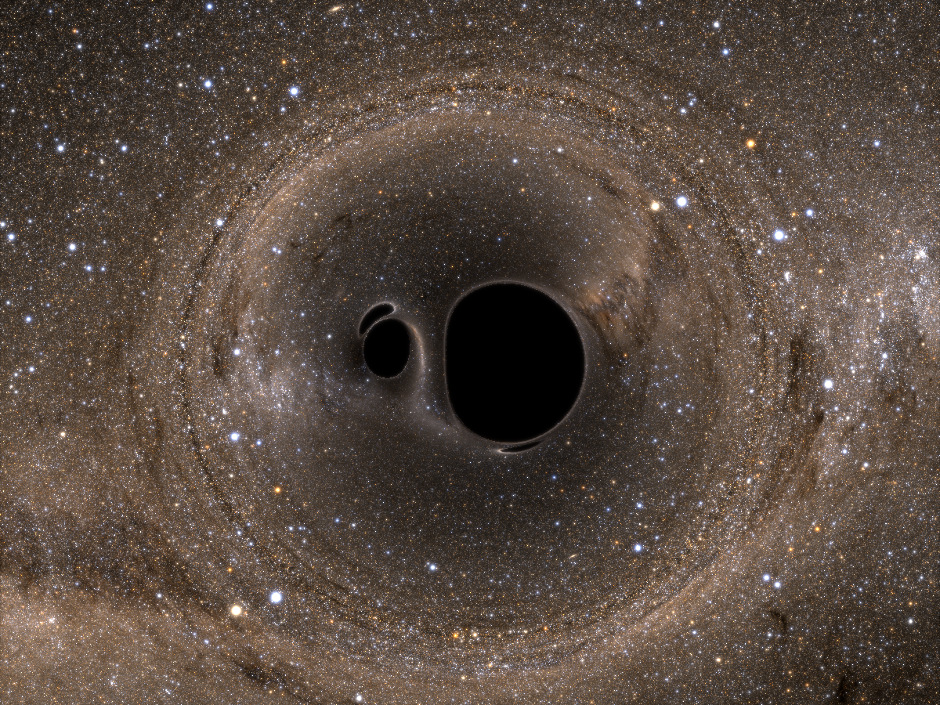 On 14 September 2015, Laser Interferometer Gravitational-wave Observatory (LIGO) detected gravitational waves from two merging black holes. The Fermi Space Telescope detected a burst of gamma rays 0.4 seconds later. New research suggests that the burst occurred because the two black holes lived and died inside a single, massive star. This is a simulation of two merging black holes in front of the Milky Way. Image credit: Andy Bohn, François Hébert, William Throwe, Darius Bunandar, Katherine Henriksson, Mark A. Scheel, and Nicholas W. Taylor.