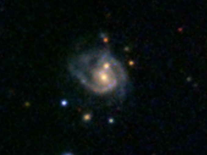 This super spiral, catalogued as 2MASXJ08542169+0449308, contains two galactic nuclei, instead of just the usual one, and thus looks like two eggs frying in a pan. Image credit: SDSS.