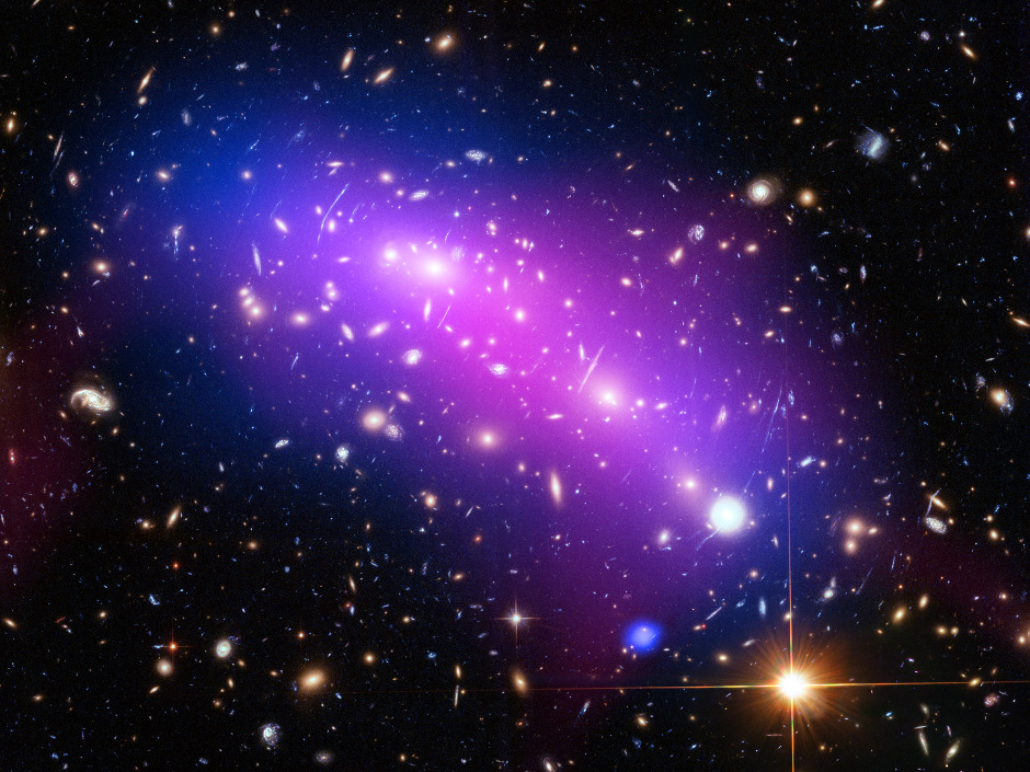 In this picture we see a multi-spectral view of MACSJ0416.1-2403 (or MACSJ0416 for short), the site of two colliding galaxy clusters some 4.3billion light-years from Earth in the constellation Eridanus. Click the image for a full-size version. Image credit: NASA, ESA, CXC, NRAO/AUI/NSF, STScI, and G. Ogrean (Stanford University). Acknowledgment: NASA, ESA, and J. Lotz (STScI), and the HFF team.