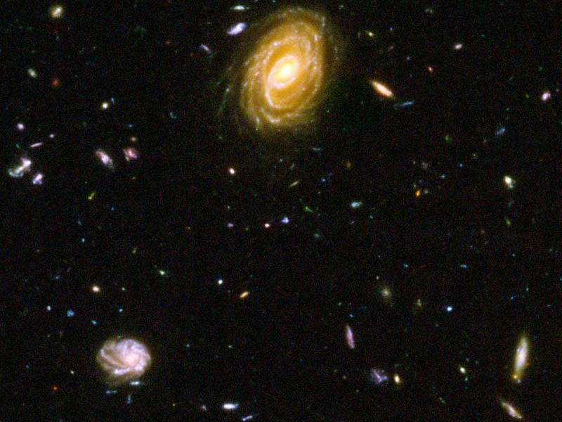An image of distant galaxies forming stars. Image credit: NASA, ESA and Bahram Mobasher.