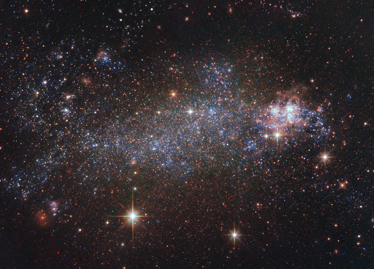 The irregular galaxy NGC5408 viewed by the NASA/ESA Hubble Space Telescope. The galaxy is located some 16million light-years away and hosts an ultra-luminous X-ray source — NGC5408X-1 — a binary system consisting of a stellar remnant that is feeding on gas from a companion star at an especially high rate. Scientists using ESA's XMM-Newton have discovered gas streaming away at a quarter of the speed of light. Image credit: ESA/Hubble & NASA. Acknowledgement: J. Schmidt.