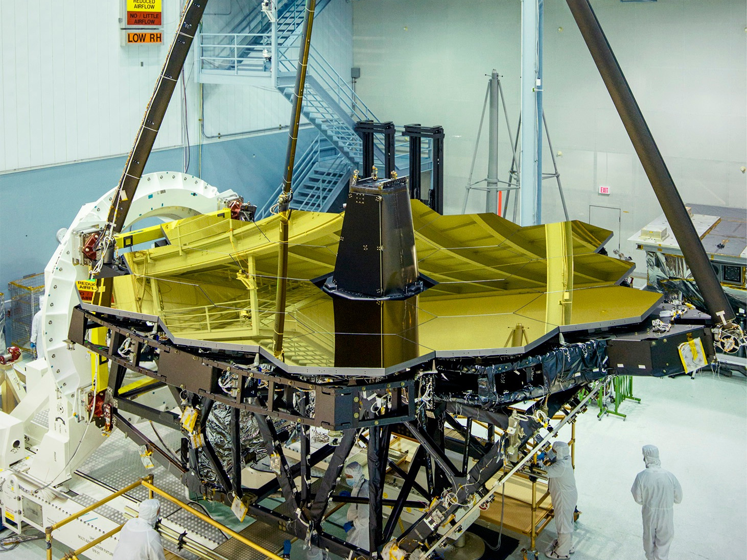 Standing tall and glimmering gold inside NASA's Goddard Space Flight Center's clean room in Greenbelt, Maryland is the James Webb Space Telescope primary mirror. With an aperture of 6.5metres, it will be the largest yet sent into space. Image credits: NASA/Chris Gunn.