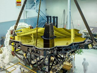 Standing tall and glimmering gold inside NASA's Goddard Space Flight Center's clean room in Greenbelt, Maryland is the James Webb Space Telescope primary mirror. With an aperture of 6.5&nsp;metres, It will be the largest yet sent into space. Image credits: NASA/Chris Gunn.