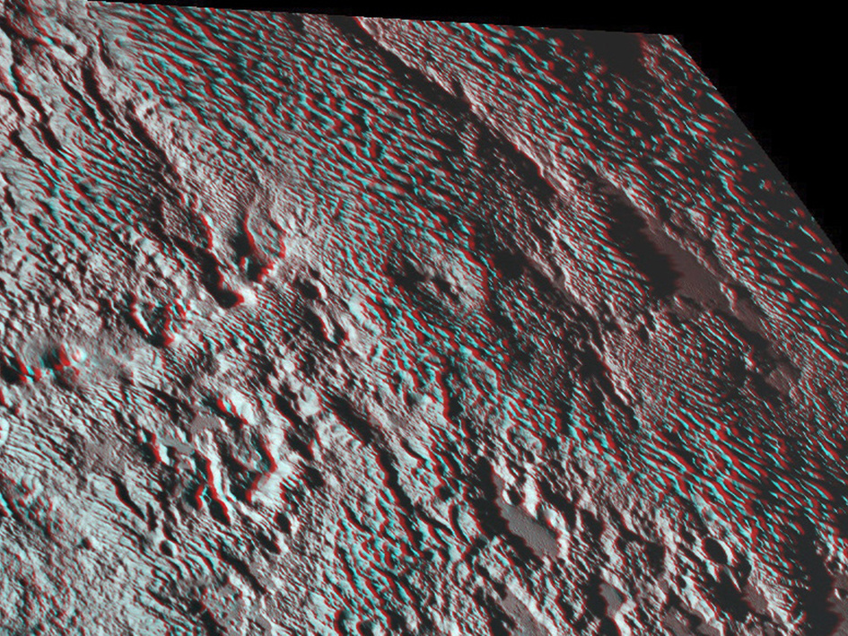 """Grab your red and green 3-D spectacles to fully appreciate New Horizons' view of the """"bladed"""" terrain just east of Tombaugh Regio, the informal name given to Pluto's large heart-shaped surface feature. Formally named Tartarus Dorsa, they align from north to south, reach hundreds of feet high and are typically spaced a few miles apart. Image credits: NASA/JHUAPL/SwRI."""
