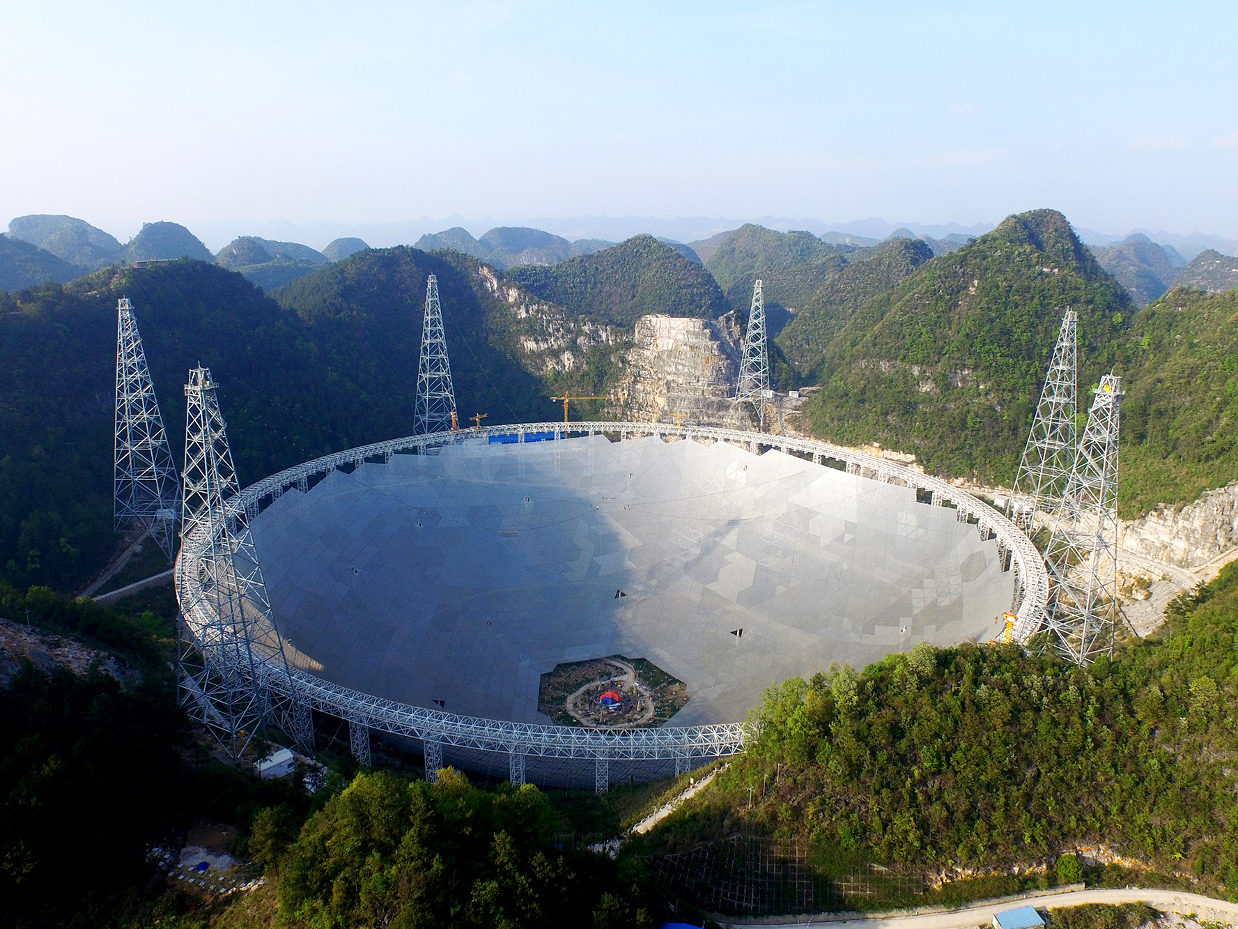 The Five hundred metre Aperture Spherical Telescope (FAST) is a radio telescope under construction in a natural basin in Pingtang County, Guizhou Province, southwest China. Construction on the FAST project began in 2011 and is scheduled for completion by September 2016. Image credit: © NAOC.