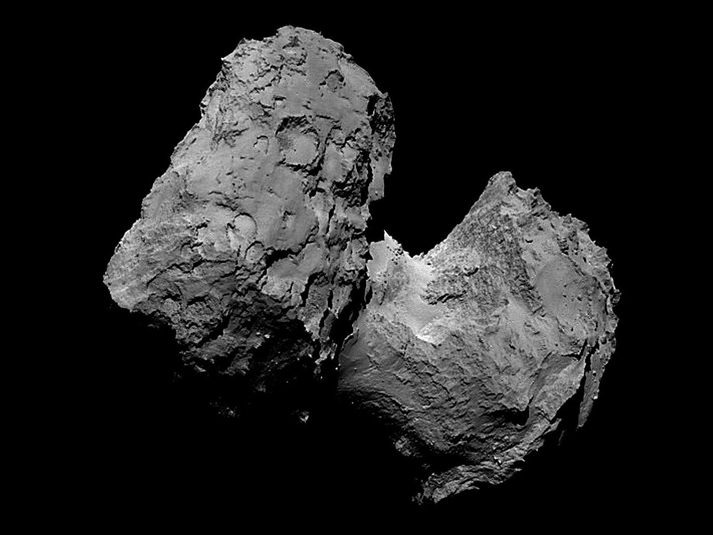"""The bizarre rubber duck-shaped nucleus of Comet 67P/Churyumov-Gerasimenko (67P) is """"bi-lobed,"""" meaning it has two larger parts connected by a thinner neck. Image credit: European Space Agency."""