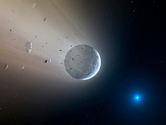 In this artist's impression, a fragmenting rocky body rich in calcium-carbonate (CaCO3) is losing its outer layers to be accreted by the white dwarf star SDSSJ1043+0855 that it orbits. Image credits: CfA/Mark A. Garlick.